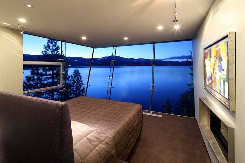 The master bedroom overlooks the lake.