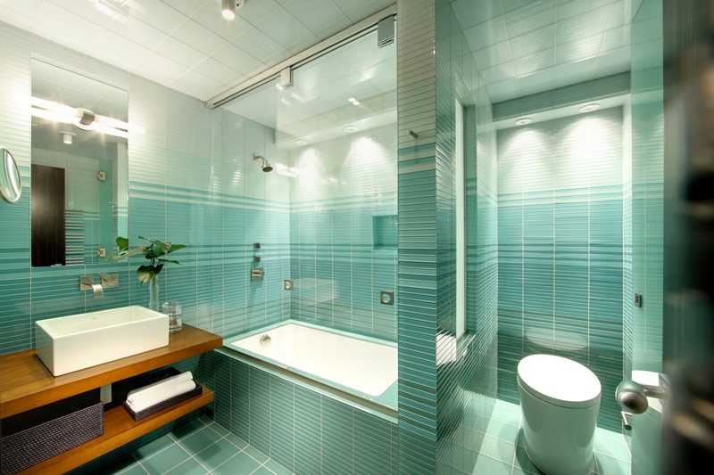Guests are invited to this blue bathroom.
