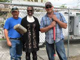 Principal Carol Brooks stands with two men who dug out the time capsule at Alberta Martone Elementary School