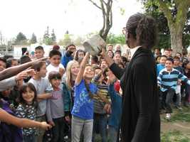 Principal Carol Brooks held the Alberta Martone Elementary time capsule up for her students to see.