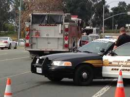 Authorities in Stockton are investigating a suspicious device that has prompted the closure of a highway overcrossing Thursday.