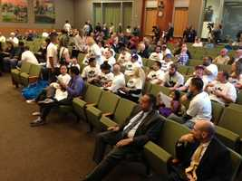 The crowd at City Hall waits to hear from City Manager John Shirey on Thursday evening (March 21, 2013).