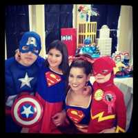 """22.) Our superhero family. This was taken at my son's birthday party this year at the """"Hall of Justice."""""""