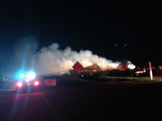 Crews are letting a three-alarm structure fire at the Maine Prairie Airport, near Dixon, burn off on its own, officials said Friday.