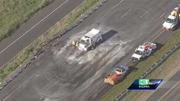 Caltrans crews repair westbound lanes on Interstate 80 near Davis following Thursday's crash that killed two people.
