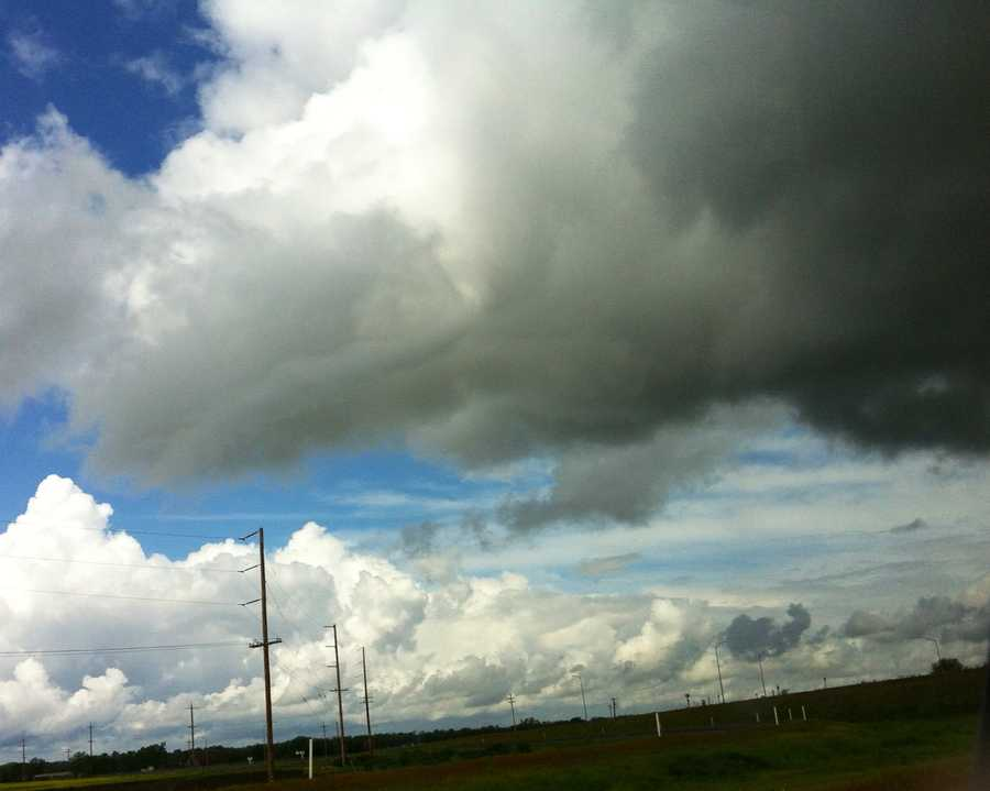 Dark clouds moved over Highway 99 at Highway 70 on Sunday.