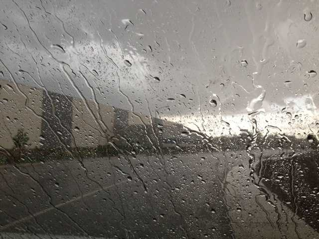 Rain poured down on this car windshield on Sunday afternoon in Davis.