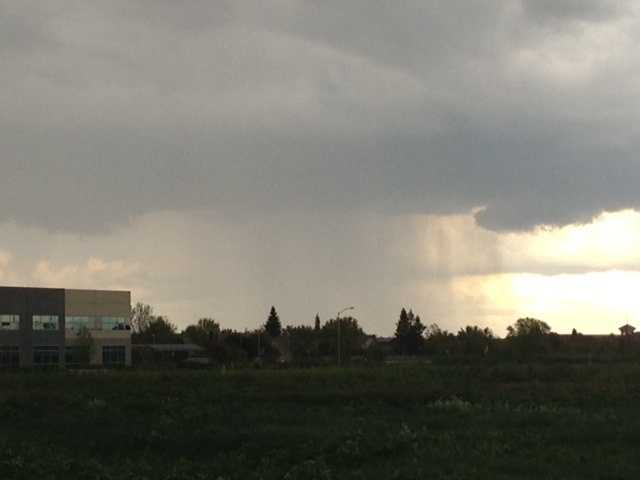 Rainy streaks were seen in the clouds to the northwest of Davis on Sunday afternoon.