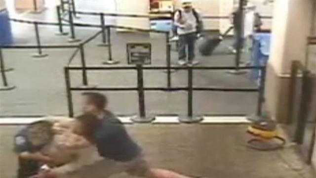 Transportation Security Adminstration cameras caught an incident on tape of a woman attacking a security officer and a police officer from California detaining the suspect.