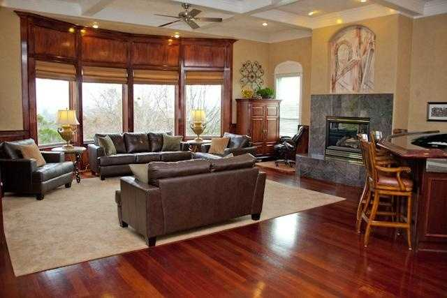 This home includes hardwood floors, dual wrought iron stairways, cherry cabinets and flooring.