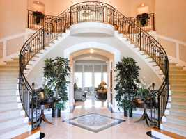 The home features this dual wrought iron stairways.