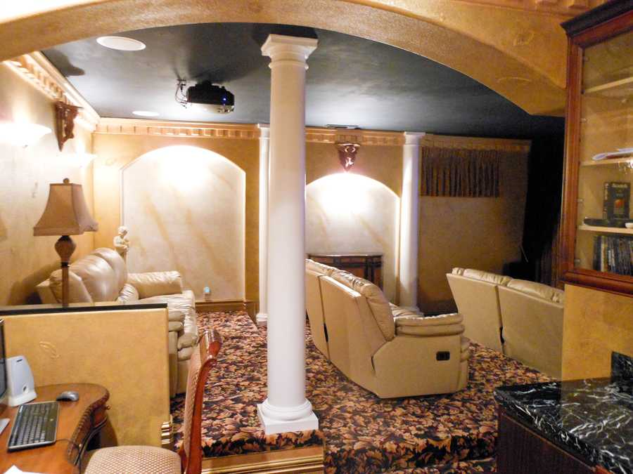 Residents and guests can enjoy this home theatre and couches.