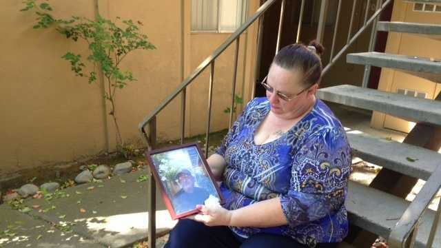 Debbie Jensen sitting outside her home (April 9, 2013)