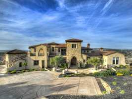 This home is situated among the area's most prestigious golf community.
