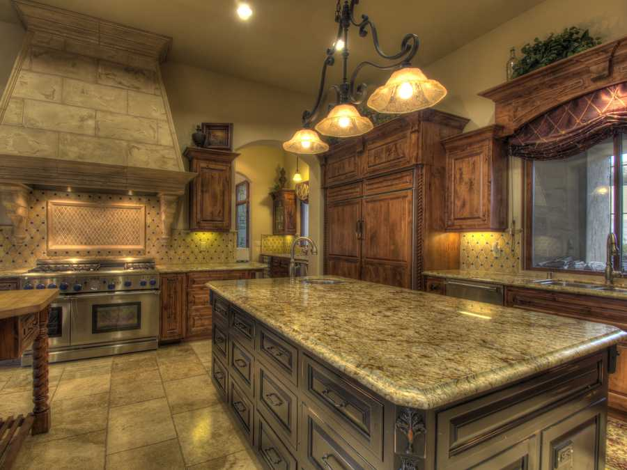The kitchen is suitable for the gourmet chef at heart. He or she will use a double island, professional appliances and furniture grade alder cabinetry.