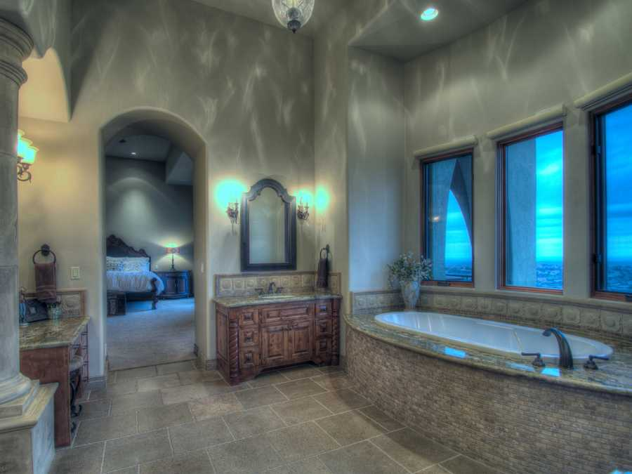 The master bedroom and bathroom has an entry featuring a 40-foot barreled ceiling corridor.