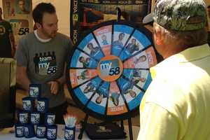 Mike from Team My58 giving away prizes