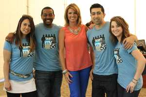 Team My58 posing with Kellie DeMarco
