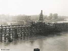 Then: Here's another view of the Southern Pacific Railroad bridge. The current bridge in its place, the I Street Bridge, is about 100 yards south from where the original bridge stood.