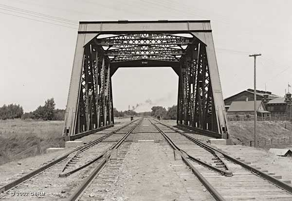 Then: This bridge that was in the Land Park neighborhood no longer exists. It crossed what today is Riverside Boulevard. It used to be Riverside Avenue.