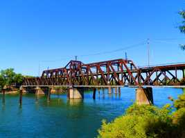 Now: The I Street Bridge is a metal truss swing bridge located on I Street and crosses the Sacramento River, connecting Yolo and Sacramento counties.