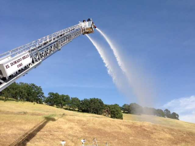 The ladder truck has an advanced ladder that can support the weight of four firefighters.