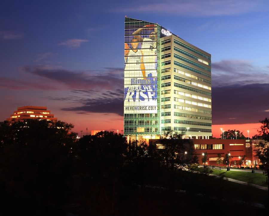 Now: In 2010, a look at the CalSTRS headquarters just a block away from the I Street Bridge. A large banner promoting the Sacramento Kings stretches across the building's facade.