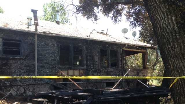 A home was damaged by flames from a fire that was burning along Highway 128.