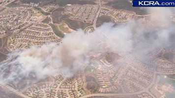See photos as the fire approaches a residential area in Camarillo: