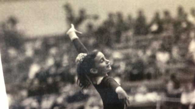 An old photograph highlights one of the six former teammates performing a routine.