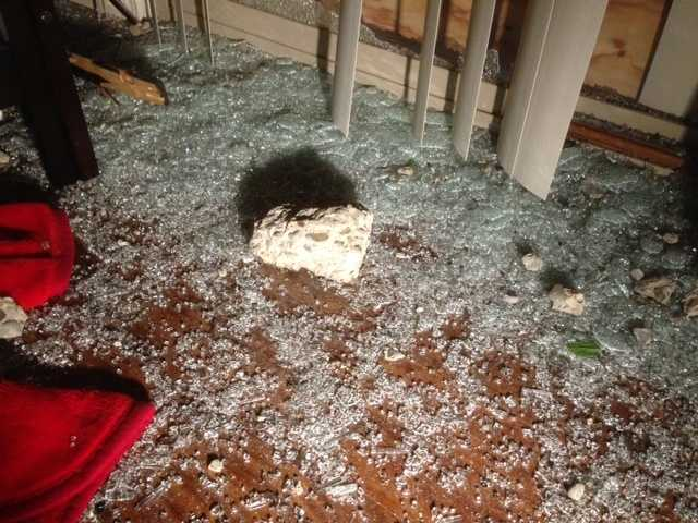 A car slammed through a sound wall, sending pieces of concrete into two backyards, police said Wednesday (May 8, 2013).