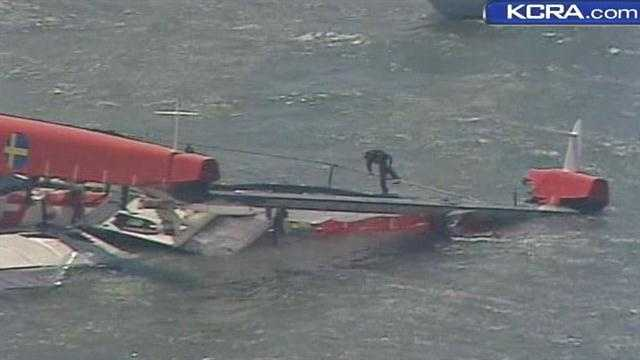 A 72-foot-long sailboat capsized in San Francisco Bay while practicing for the upcoming America's Cup on Thursday.