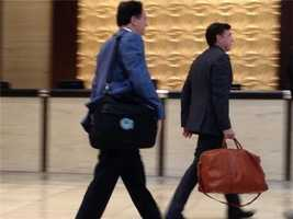 To the right, Wyc Grousbeck, co-owner of the Boston Celtics, walks through the lobby in Dallas.