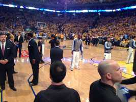 Players warm up before Thursday night's game at Oracle Arena.