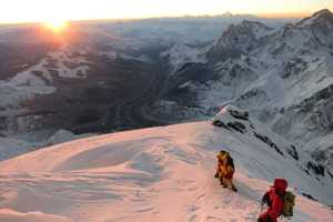 Baranov and the Sherpa team enjoy a sunrise over Tibet.