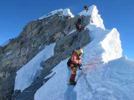 The 40-foot-tall rock is the scene of notorious traffic jams leading to and from the summit. The Alpenglow team encountered few people on their summit day.