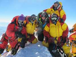 Expeditions rely on local Sherpas to carry equipment, set and clear camps along the mountain.