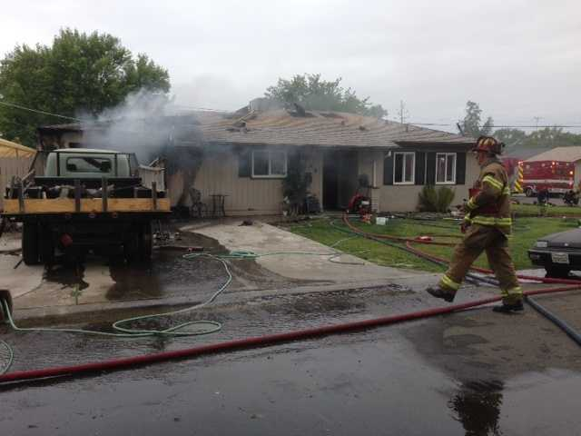 Sacramento Metro Fire crews battled a garage fire Monday at a home located on Shadowglen Road in North Highlands. (May 27, 2013)