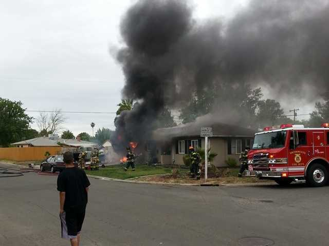 Sacramento Metro Fire crews battled a garage fire Monday at a home located on Shadowglen Road in North Highlands.(May 27, 2013)
