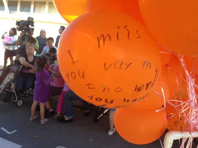 Friends and family of a 10-year-old girl who was shot to death while watching television with her parents gathered in North Highlands on Tuesday for a vigil (May 28, 2013).