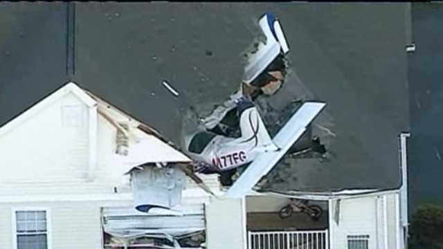 Plane crashes into apartment building