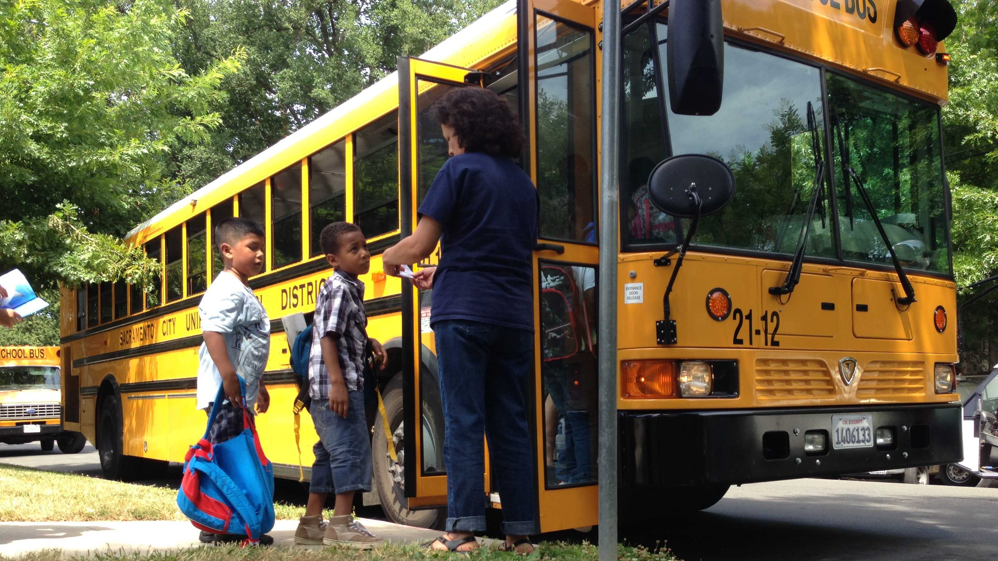Students board buses at Washington Elementary School in Sacramento, one of seven schools slated for closure this fall (June 11, 2013).