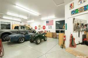 In addition to the attached four-car garage, the home also offers a detached shop and garage for up to six more cars.