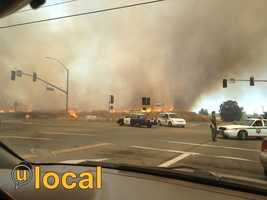 KCRA's u local members captured these photos of a fast-moving grass fire burning west of Roseville on Thursday.