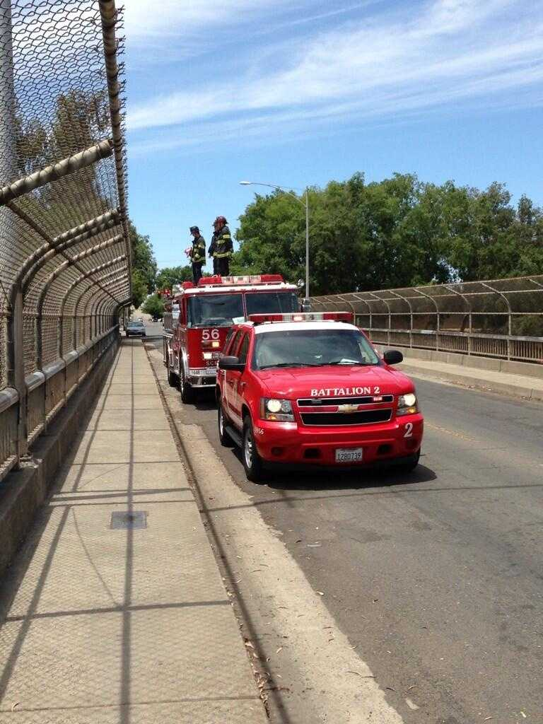 Sac Fire Engine 56 and BC 2 are set up on the 41st Avenue overpass to honor fallen Army Corp. Ray Ramirez (June 14, 2013).