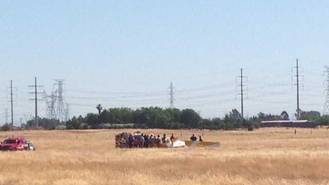 Fire crews stand over wreckage of ultralight crash near Elverta, Calif