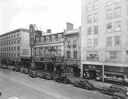 """900 K Street: River City Bank located at 900 K Street once housed the Owl Drug Company in the early 1900s. Some of its neighbors included Moss Women's Clothing and the Fox Senator Theater. The theater opened in 1924 to nearly 5,000 moviegoers when it debuted """"The Only Woman."""""""