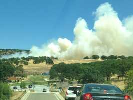 Crews battled a small grass fire Wednesday off Broadstone Parkway in Folsom (June 19, 2013).