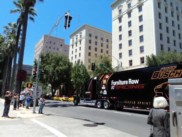 Kurt Busch's hauler rolled by the state Capitol on Thursday.