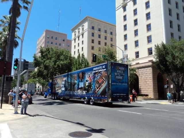 """Another hauler advertised the NASCAR Hall of Fame in Charlotte, N.C., where """"The Race Lives On."""""""